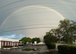 Image of clinic with full rainbow in the background.